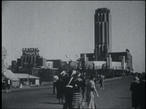 b/w 1933 people walking on midway with general motors building in background / chicago world's fair - chicago world's fair stock videos and b-roll footage