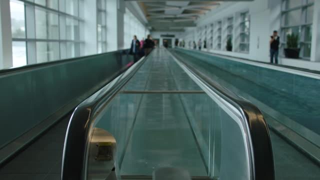 ms td people walking on moving walkway at sfo - pedestrian walkway stock videos & royalty-free footage