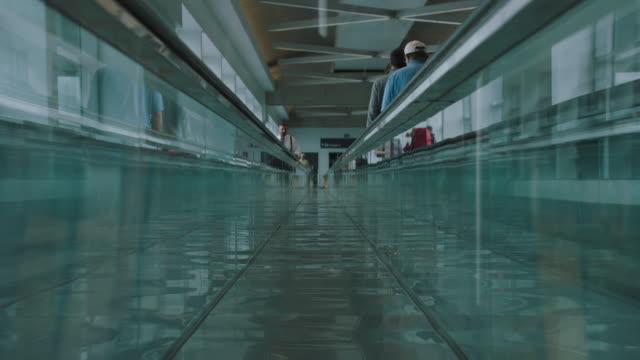 ms tu people walking on moving walkway at sfo - san francisco international airport stock videos & royalty-free footage