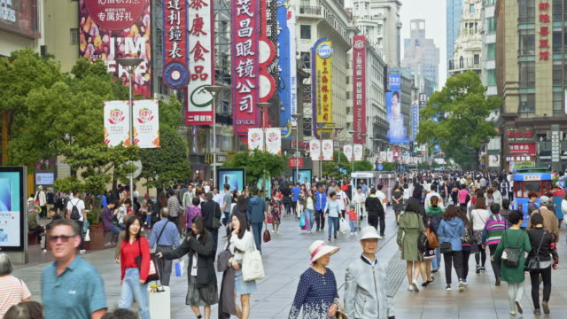 people walking on nanjing road, shanghai, china - chinese flag stock videos & royalty-free footage