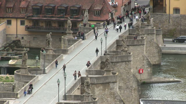 ms people walking on old bridge over river main / wurzburg, bavaria, germany - wurzburg stock videos and b-roll footage