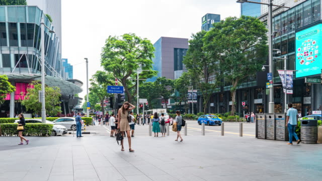 people walking on orchard road, busy orchard road - pedestrian zone stock videos & royalty-free footage