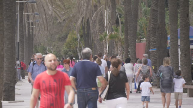 People walking on Paseo Maritimo, Marbella, Andalucia, Spain, Europe