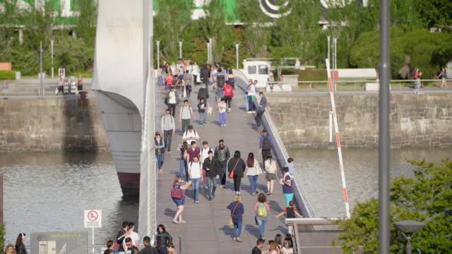 people walking on peunte de la mujer in buenos aires - puente de la mujer stock videos & royalty-free footage