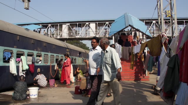 people walking on platform in india - railway station stock videos & royalty-free footage