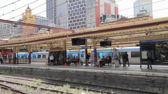 WS T/L People walking on platform / Melbourne, Victoria, Australia