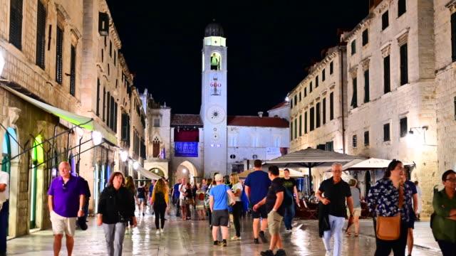 people walking on pred dvorom street in dubrovnik, croatia - history stock videos & royalty-free footage