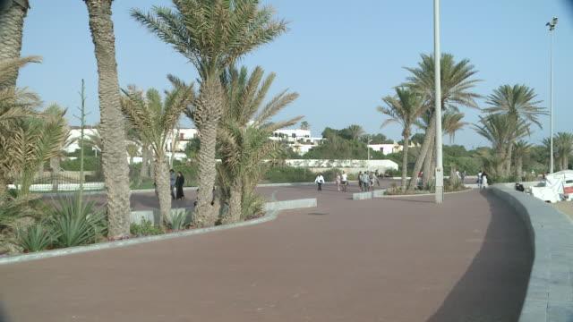 WS People walking on  promenade beach  / Agadir, Unspecified, Morocco Agadir, Unspecified, Morocco