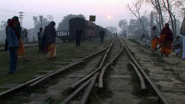 People walking on railway track