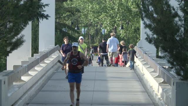 ms people walking on short bridge  / calgary, alberta, canada - gemeinsam gehen stock-videos und b-roll-filmmaterial
