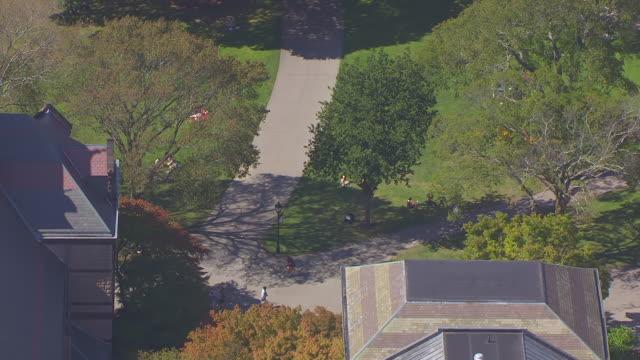ws aerial pov people walking on sidewalk in brown university campus/ providence, rhode island, united states - brown stock videos & royalty-free footage
