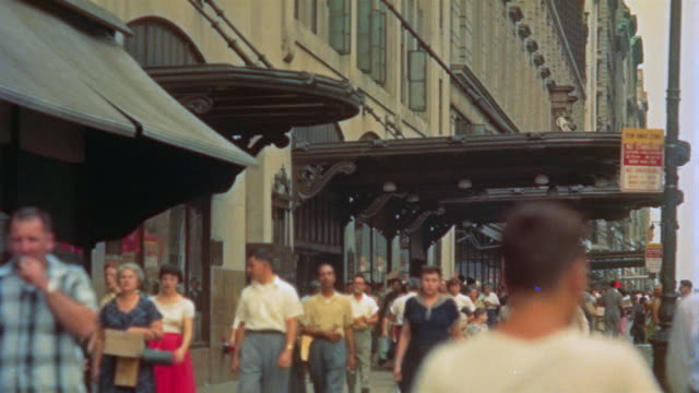 1955 ms people walking on sidewalk outside macy's department store along 34th street / new york city - department store stock videos & royalty-free footage