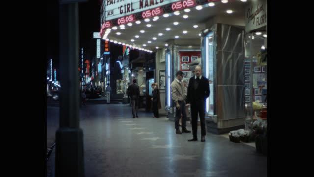 people walking on sidewalk outside movie theater - looking away stock videos & royalty-free footage