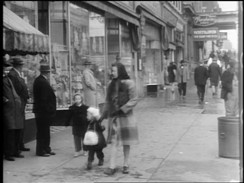 b/w 1944 people walking on sidewalk past shops in winter / lexington, nc / documentary - 1944 stock videos and b-roll footage