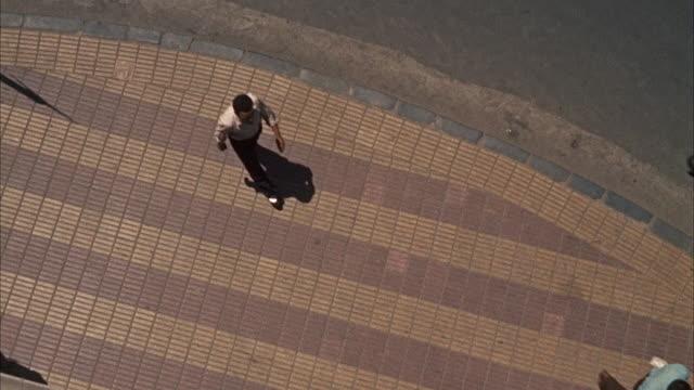 MS People walking on sidewalk
