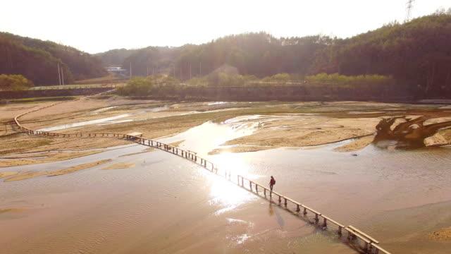 people walking on single log bridge at naeseongcheon stream in museommaeul village - north gyeongsang province stock videos & royalty-free footage