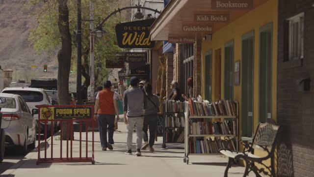 people walking on small town sidewalk near stores / moab, utah, united states - moab utah stock videos & royalty-free footage