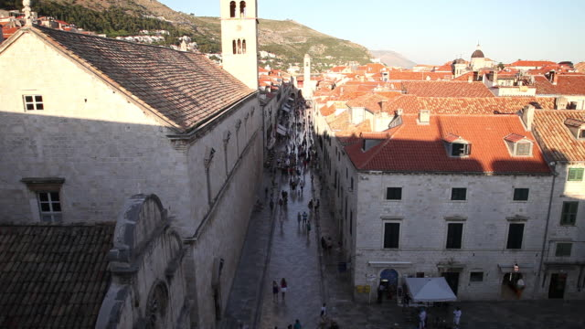 People walking on Stradun street