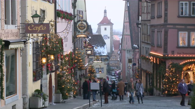 ms people walking on street at morning/ rothenburg o.d. tauber, bavaria, germany - western script stock videos & royalty-free footage