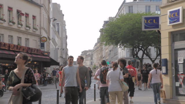 ms people walking on street during day / paris, france - frankreich stock-videos und b-roll-filmmaterial