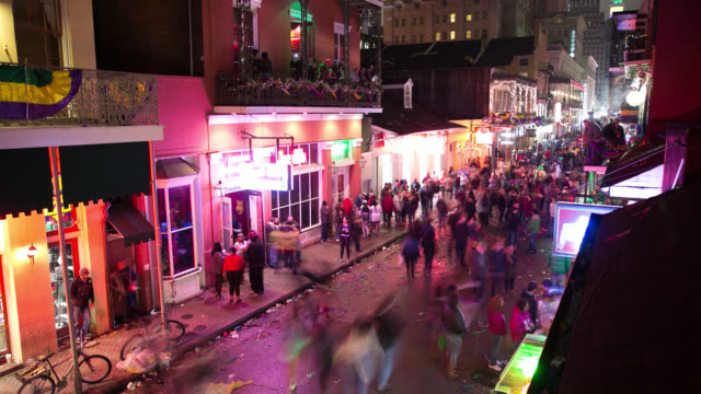 ws ha t/l people walking on street during mardi gras celebration at night - street party stock videos & royalty-free footage