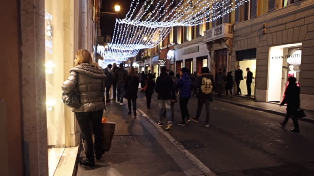 ms people walking on street for christmas shopping in via dei condotti / rome, italy - window display stock videos and b-roll footage