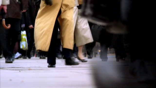 cu, selective focus, people walking on street, low section, london, england - foot stock videos & royalty-free footage