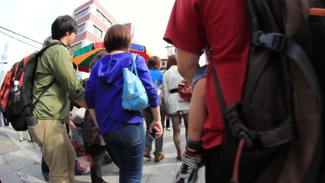 ms pov people walking on street near senso ji temple / asakusa, tokyo, japan - randoseru stock videos & royalty-free footage