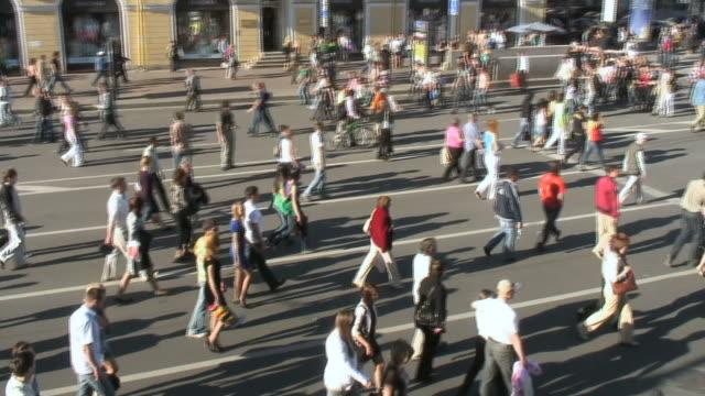 ws pan people walking on street of nevsky prospekt / saint petersburg, russia   - st. petersburg russia stock videos & royalty-free footage