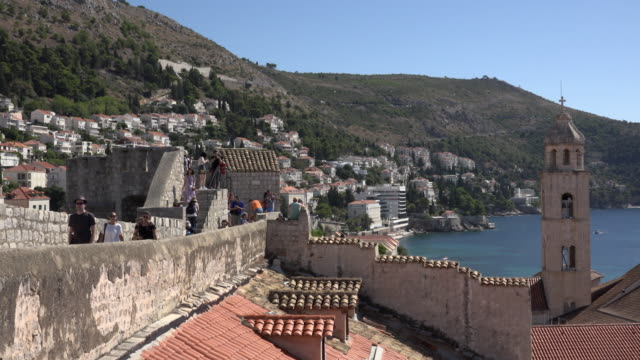 People walking on the city walls of Dubrovnik