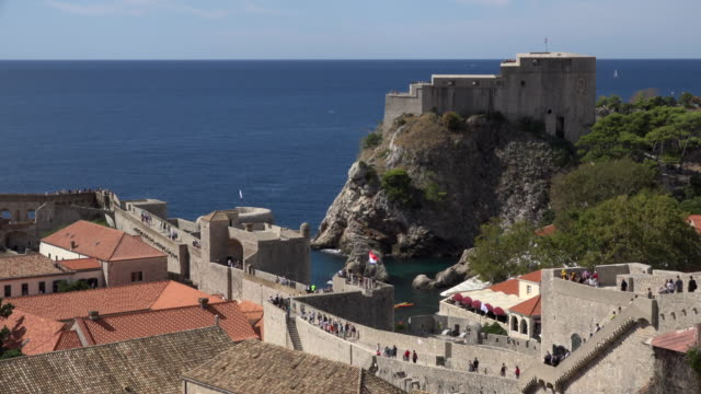 People walking on the city walls of Dubrovnik with Saint Lawrence fortress, Fort Lovrijenac