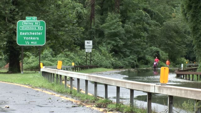 people walking on the deserted bronx river parkway after parkway was closed from flooding due to hurricane irene hurrciane irene aftermath on august... - hurricane irene stock videos & royalty-free footage