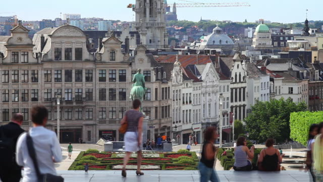 t/l people walking on the mont des arts (mount of the arts) in front of the old twon of brussels  - animal representation stock videos & royalty-free footage