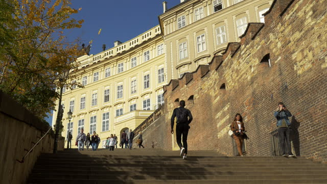 people walking on the old castle stairs in prague - czech republic stock videos & royalty-free footage