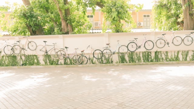 people walking on the road.(timelapse) - stock video - bicycle parking station stock videos and b-roll footage