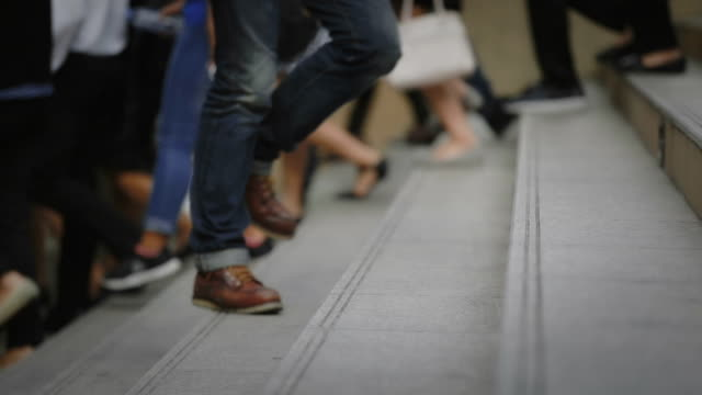people walking on the sidewalk, slow motion - scale video stock e b–roll