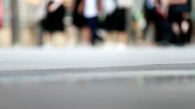 People walking on the sidewalk, slow motion
