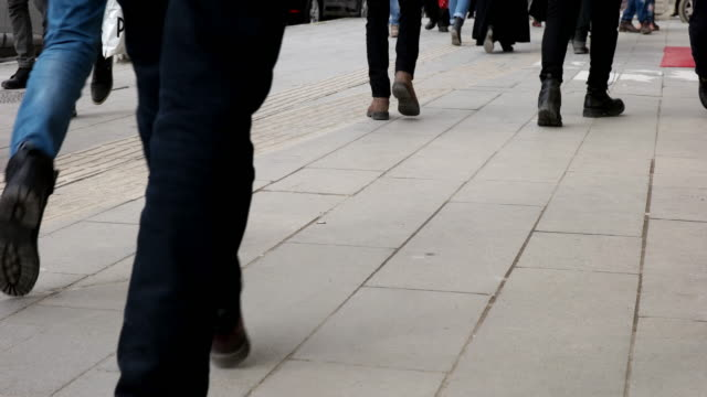 People walking on the sidewalk