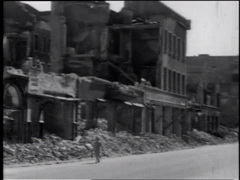 people walking on the street near buildings destroyed in wwii / germany - postwar stock videos & royalty-free footage