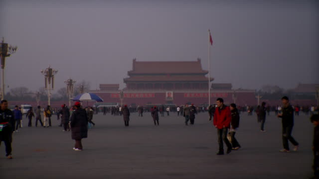 ws people walking on tiananmen square, gate of heavenly peace in background, beijing, china - tiananmen gate of heavenly peace stock videos & royalty-free footage