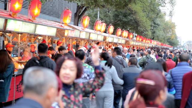 People walking on Wangfujing Street in Beijing,Chaina