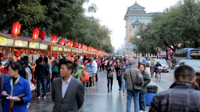 people walking on wangfujing street in beijing,chaina - business finance and industry stock videos & royalty-free footage