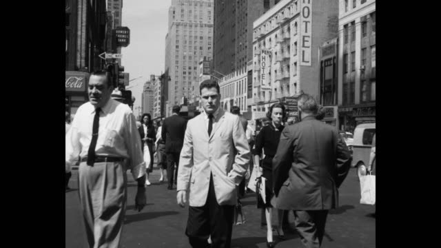 people walking on west 34th street, manhattan, new york city, new york state, usa - 1950 stock-videos und b-roll-filmmaterial