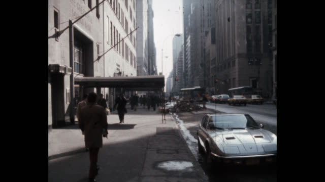 1979 people walking on west 57th street, new york city, new york state, usa - midtown manhattan stock videos & royalty-free footage