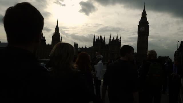 people walking on westminster bridge in london - politics and government stock videos & royalty-free footage