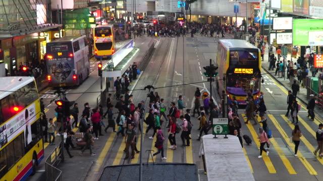 people walking on zebra cross at causeway bay, hong kong. - central district hong kong stock videos & royalty-free footage