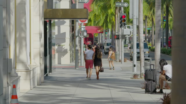 MS People walking outside of shop / Rodeo Drive, Beverly Hills, Los Angeles County, California, United States