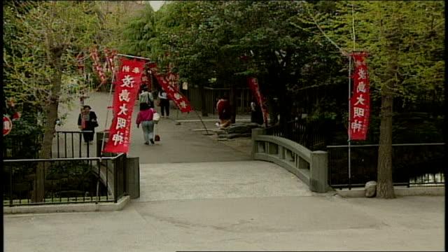 people walking over small bridge in asakusa kannon temple japan - shitamachi stock videos and b-roll footage