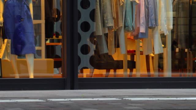people walking past fashion store - window display stock videos & royalty-free footage