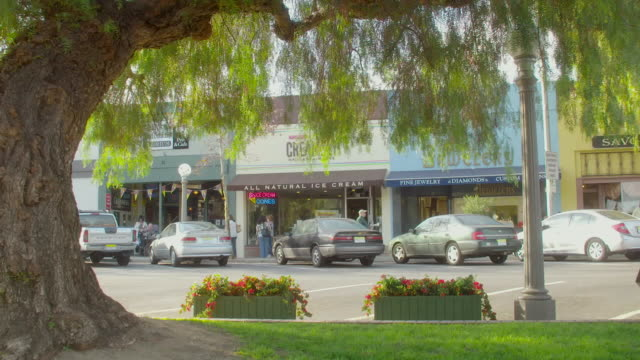 ws people walking past store fronts / sierra madre, california, united states - sierra madre stock-videos und b-roll-filmmaterial
